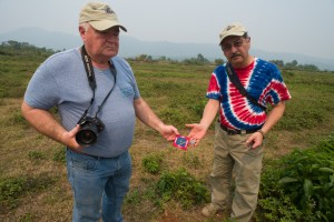 Ray and Dennis place a patch in the red dirt at Khe Sanh.