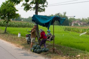 Purchasing watermelon from a roadside stand.